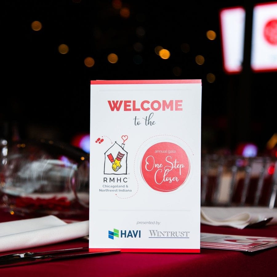 Sign welcoming attendees to gala with sponsor logos